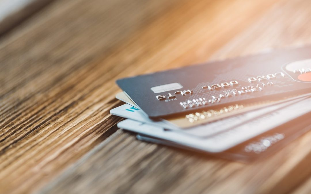 Few plastic credit cards on wooden background.